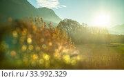 Купить «Creative landscape with blurred forefront on a sunny sky background, Austria.», фото № 33992329, снято 12 ноября 2015 г. (c) Ярослав Данильченко / Фотобанк Лори