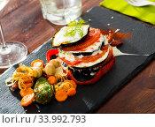 Купить «Eggplant pyramid dressed with garlic yoghurt sauce», фото № 33992793, снято 2 июля 2020 г. (c) Яков Филимонов / Фотобанк Лори