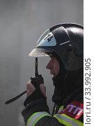 Купить «Пожарный на пепелище», эксклюзивное фото № 33992905, снято 14 июня 2020 г. (c) Дмитрий Неумоин / Фотобанк Лори