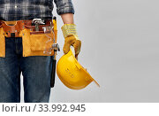worker or builder with helmet and working tools. Стоковое фото, фотограф Syda Productions / Фотобанк Лори