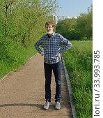 Купить «Tired man on walk in park during coronavirus pandemic (covid-19)», фото № 33993785, снято 9 июня 2020 г. (c) Валерия Попова / Фотобанк Лори