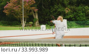 Купить «Tennis players playing a point», видеоролик № 33993989, снято 11 марта 2020 г. (c) Wavebreak Media / Фотобанк Лори