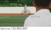 Купить «Tennis players playing a point», видеоролик № 33993997, снято 11 марта 2020 г. (c) Wavebreak Media / Фотобанк Лори