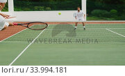 Купить «Tennis players playing a point», видеоролик № 33994181, снято 11 марта 2020 г. (c) Wavebreak Media / Фотобанк Лори