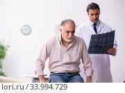 Купить «Old patient visiting young male doctor», фото № 33994729, снято 25 октября 2019 г. (c) Elnur / Фотобанк Лори
