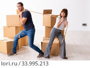 Купить «Young pair and many boxes in divorce settlement concept», фото № 33995213, снято 3 сентября 2019 г. (c) Elnur / Фотобанк Лори
