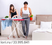 Young woman doing ironing for her husband. Стоковое фото, фотограф Elnur / Фотобанк Лори