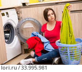 Woman doing laundry at home. Стоковое фото, фотограф Elnur / Фотобанк Лори