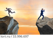 Купить «Boss holding his employee in retention concept», фото № 33996697, снято 3 августа 2020 г. (c) Elnur / Фотобанк Лори