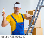 Купить «Painter contractor working with virtual reality goggles», фото № 33996717, снято 23 мая 2017 г. (c) Elnur / Фотобанк Лори