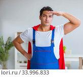 Купить «Super hero repairman working at home», фото № 33996833, снято 23 декабря 2016 г. (c) Elnur / Фотобанк Лори