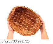 Купить «Hand holds vintage weave wicker basket isolated on a white background», фото № 33998725, снято 5 июля 2020 г. (c) age Fotostock / Фотобанк Лори