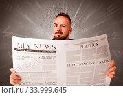 Купить «Young smart businessman reading daily newspaper with alphabet letters above his head», фото № 33999645, снято 4 июля 2020 г. (c) easy Fotostock / Фотобанк Лори