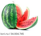Big ripe watermelon and slices on a white background. Стоковое фото, фотограф Zoonar.com/Oleg Begunenko / age Fotostock / Фотобанк Лори