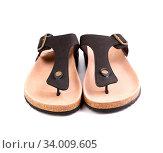 Купить «A couples brown sandals close-up on the white background.», фото № 34009605, снято 3 июля 2020 г. (c) age Fotostock / Фотобанк Лори