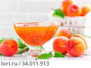 Купить «Apricot jam and fresh fruits with leaves on white wooden table», фото № 34011913, снято 6 июля 2020 г. (c) easy Fotostock / Фотобанк Лори