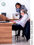Купить «The male employee suffering from heart attack in the office», фото № 34012449, снято 4 июля 2020 г. (c) easy Fotostock / Фотобанк Лори