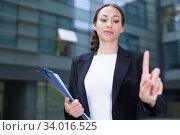 Купить «Female office manager is asking companion to wait», фото № 34016525, снято 26 июня 2017 г. (c) Яков Филимонов / Фотобанк Лори