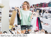 Woman is showing purchases in shoes shop. Стоковое фото, фотограф Яков Филимонов / Фотобанк Лори