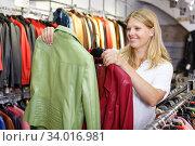 Купить «Woman choosing leather jacket», фото № 34016981, снято 5 сентября 2018 г. (c) Яков Филимонов / Фотобанк Лори