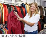 Купить «Woman choosing leather jacket», фото № 34016985, снято 5 сентября 2018 г. (c) Яков Филимонов / Фотобанк Лори
