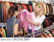 Купить «Two women in leather clothes shop», фото № 34016989, снято 5 сентября 2018 г. (c) Яков Филимонов / Фотобанк Лори