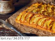Homemade rustic apple pie on a wooden old vintage table. Dark background. Seasonal bakery concept. Стоковое фото, фотограф Nataliia Zhekova / Фотобанк Лори