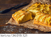 Купить «Homemade rustic apple pie on a wooden old vintage table. Dark background. Seasonal bakery concept.», фото № 34019121, снято 1 марта 2019 г. (c) Nataliia Zhekova / Фотобанк Лори