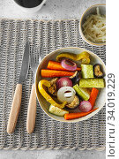 Купить «Mixed vegetable stir fry with parmesan cheese. Roasted vegetables mix on the plate with cutlery on the wicker serving mat, food above. Vegan food background. Tender seasonal vegetables stir fry. Vegan food», фото № 34019229, снято 29 июля 2019 г. (c) Nataliia Zhekova / Фотобанк Лори
