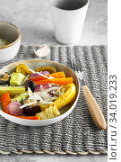 Купить «Mixed vegetable stir fry with parmesan cheese. Roasted vegetables mix on the plate with cutlery on the wicker serving mat, food above. Tender seasonal vegetables stir fry. Vegan food», фото № 34019233, снято 29 июля 2019 г. (c) Nataliia Zhekova / Фотобанк Лори