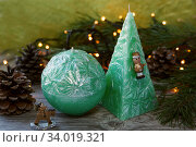 Купить «andles in the shape of a pyramid and sphere», фото № 34019321, снято 17 декабря 2015 г. (c) Nataliia Zhekova / Фотобанк Лори