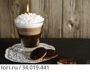 Handmade candle in the form of cocktail glass with coffee and creamy white foam. Стоковое фото, фотограф Nataliia Zhekova / Фотобанк Лори