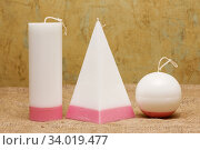 Купить «Handmade candles in the shape of a pyramid, cube, cylinder and sphere», фото № 34019477, снято 23 мая 2017 г. (c) Nataliia Zhekova / Фотобанк Лори