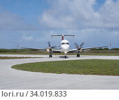 Купить «Beechcraft 1900 aircraft arriving to pick up passengers on Astove Atoll, Seychelles, November 2019.», фото № 34019833, снято 5 июля 2020 г. (c) Nature Picture Library / Фотобанк Лори