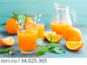 Купить «Orange juice in glass and fresh fruits with leaves on wooden background, vitamin drink or cocktail», фото № 34025365, снято 4 июля 2020 г. (c) easy Fotostock / Фотобанк Лори