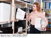 Girl choosing boxes storage. Стоковое фото, фотограф Яков Филимонов / Фотобанк Лори