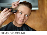 Купить «Women's haircut at home», фото № 34030525, снято 13 июня 2020 г. (c) Знаменский Олег / Фотобанк Лори