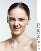 Headshot of emotional female face portrait with disgust pucker facial expression. Стоковое фото, фотограф Serg Zastavkin / Фотобанк Лори