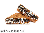 Купить «Cake decorated with chocolate cream icing and white chips», фото № 34030793, снято 11 июля 2016 г. (c) Nataliia Zhekova / Фотобанк Лори