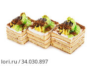 biscuit cake decorated with cream banana isolated on white. Стоковое фото, фотограф Nataliia Zhekova / Фотобанк Лори