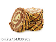 Купить «Slices of sweet roll cake isolated on white», фото № 34030905, снято 6 апреля 2017 г. (c) Nataliia Zhekova / Фотобанк Лори