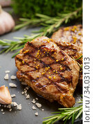 Купить «Grilled beef steaks with spices.», фото № 34031013, снято 20 марта 2019 г. (c) Nataliia Zhekova / Фотобанк Лори