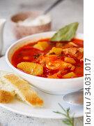 Borscht is a sour soup in Eastern Europe. Borsch includes beetroots. Стоковое фото, фотограф Nataliia Zhekova / Фотобанк Лори
