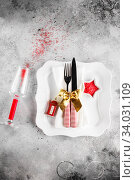 Купить «Christmas table place setting with square plate, cutlery with festive decorations gold ribbon, bauble red telephone box, star-shaped bowl with red sugar. Christmas Xmas New Year holiday backdrop», фото № 34031109, снято 12 ноября 2019 г. (c) Nataliia Zhekova / Фотобанк Лори