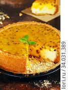 Купить «Cheese cake with passion fruit on a dark background. Cheese cake with passion fruit sauce on top, decorated with mint leaves», фото № 34031389, снято 16 декабря 2019 г. (c) Nataliia Zhekova / Фотобанк Лори