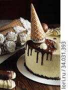 White chocolate cake decorated with popsicle on a stick, waffle cone and chocolate balls. Kids birthday cake. Стоковое фото, фотограф Nataliia Zhekova / Фотобанк Лори