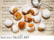 Купить «Homemade profiteroles on the music sheet with notes. Profiteroles (choux à la crème) - French choux pastry balls filled with custard or cottage cheese», фото № 34031497, снято 14 марта 2019 г. (c) Nataliia Zhekova / Фотобанк Лори