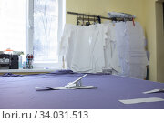 table for cutting matter in a sewing studio and patterns. Стоковое фото, фотограф Иванов Алексей / Фотобанк Лори