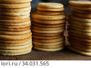 Купить «Biscuit with Danish style butter cookies and honey flavored. A stack of crunchy delicious sweet meal and useful cracker.», фото № 34031565, снято 7 февраля 2019 г. (c) Nataliia Zhekova / Фотобанк Лори