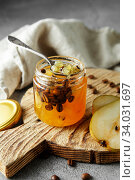 candied fruit jelly. pear marmalade with coffee beans. Jar of pear jam. Стоковое фото, фотограф Nataliia Zhekova / Фотобанк Лори